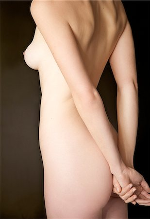 Back view of a nude woman - headless Stock Photo - Rights-Managed, Code: 822-03406962