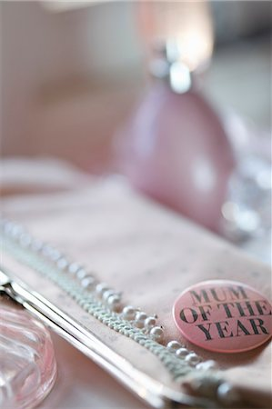 Detail of a clutch bag with a 'mum of the year' badge Stock Photo - Rights-Managed, Code: 822-03406963