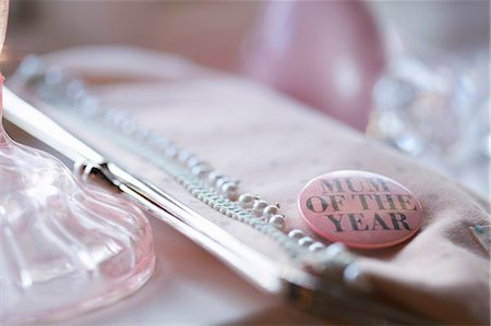 Clutch bag with a 'mum of the year' badge Stock Photo - Rights-Managed, Code: 822-03407017