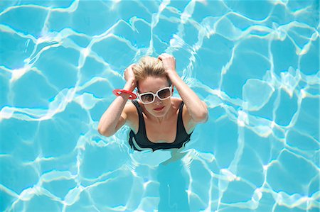 Elevated view of a woman standing in a swimming pool Stock Photo - Rights-Managed, Code: 822-03407024
