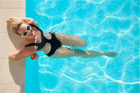 Elevated view of a woman at edge of swimming pool Stock Photo - Rights-Managed, Code: 822-03407150