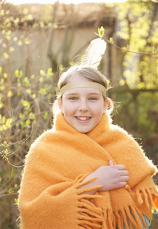 Girl wrapped in a blanket wearing Indian feather headdress Stock Photo - Rights-Managed, Code: 822-03485169