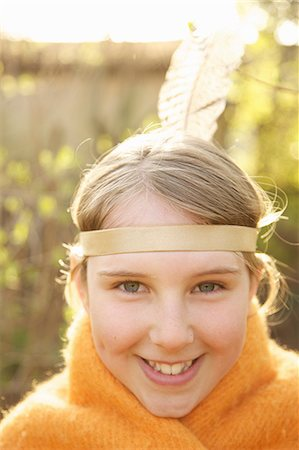 Close up of a girl wearing Indian feather headdress Stock Photo - Rights-Managed, Code: 822-03485170