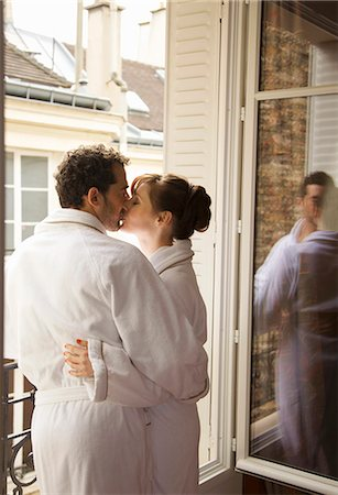 Couple kissing in front of an open window Stock Photo - Rights-Managed, Code: 822-03485184