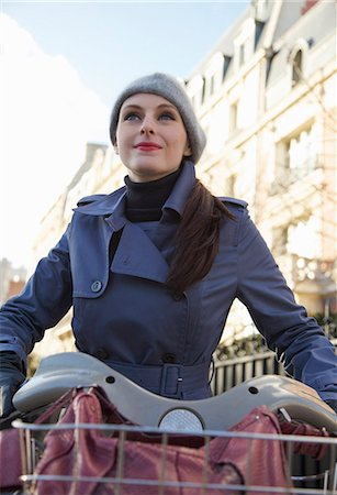 renting - Young woman on a Velib Stock Photo - Rights-Managed, Code: 822-03485183
