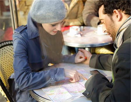 Young couple at cafe looking over a map Stock Photo - Rights-Managed, Code: 822-03485196
