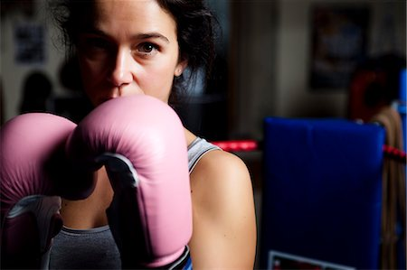 female only - Close up of a woman wearing pink boxing gloves Stock Photo - Rights-Managed, Code: 822-03485192