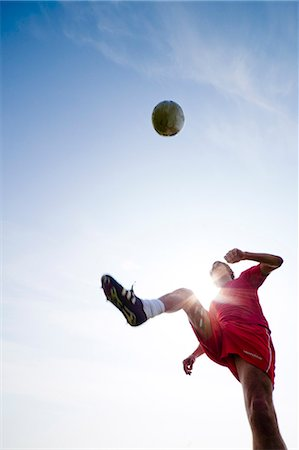 dynamic - Soccer player kicking ball Stock Photo - Rights-Managed, Code: 822-03485262