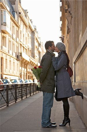 Young couple kissing in a city street Stock Photo - Rights-Managed, Code: 822-03485296