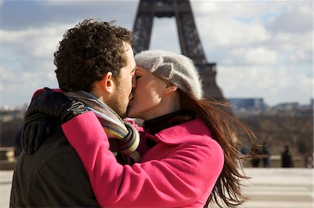Couple kissing in front of the Eiffel Tower Stock Photo - Rights-Managed, Code: 822-03485320