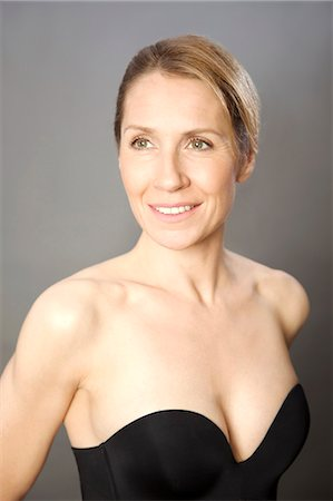 Woman wearing strapless black bodice Stock Photo - Rights-Managed, Code: 822-03485381