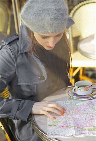 Young woman at cafe looking over a map Stock Photo - Rights-Managed, Code: 822-03485451