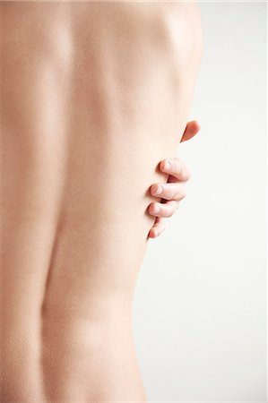 Rear view of a nude woman back and spine, headless Stock Photo - Rights-Managed, Code: 822-03485517