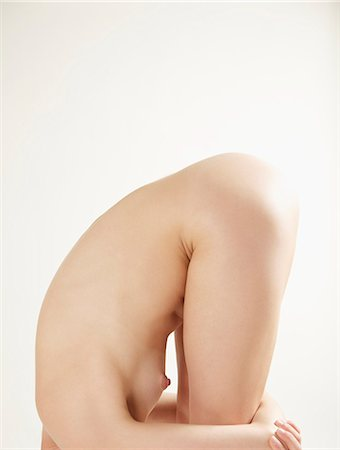 Profile of a nude woman bending over her knees, headless Stock Photo - Rights-Managed, Code: 822-03485554