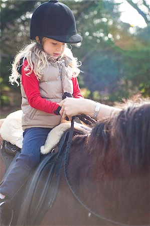 Young girl riding a horse Stock Photo - Rights-Managed, Code: 822-03485574