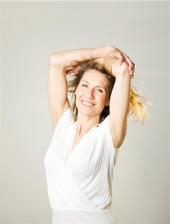 Portrait of a woman with arms crossed over head Stock Photo - Rights-Managed, Code: 822-03485607
