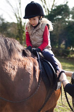 Young girl riding a horse Stock Photo - Rights-Managed, Code: 822-03485649