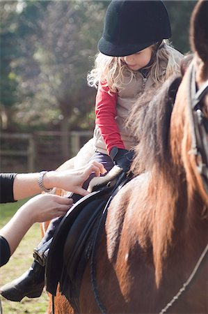 Young girl riding a horse Stock Photo - Rights-Managed, Code: 822-03485664