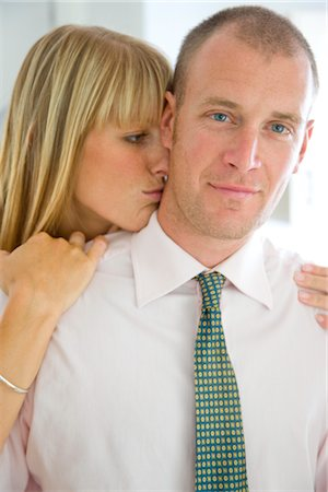Woman Kissing Man's Neck Stock Photo - Rights-Managed, Code: 822-03601624