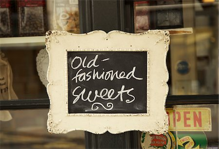 quaint - Sign on Shop Window Stock Photo - Rights-Managed, Code: 822-03601672