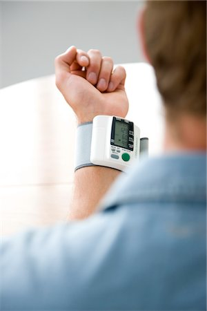 pressure - Back View of Man Wearing a Blood Pressure Meter Stock Photo - Rights-Managed, Code: 822-03601752