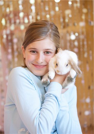 preteen girl - Girl Holding Rabbit Stock Photo - Rights-Managed, Code: 822-03601800
