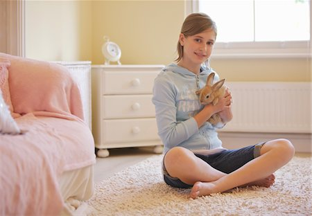 Girl Holding Rabbit Stock Photo - Rights-Managed, Code: 822-03601844