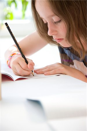 Young Girl Drawing Stock Photo - Rights-Managed, Code: 822-03601898