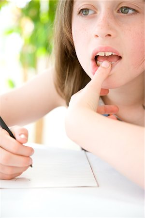 female lips drawing - Young Girl Doing Homework Stock Photo - Rights-Managed, Code: 822-03601960