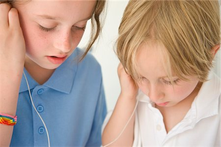 Boy and Girl Wearing Earphones Stock Photo - Rights-Managed, Code: 822-03601963
