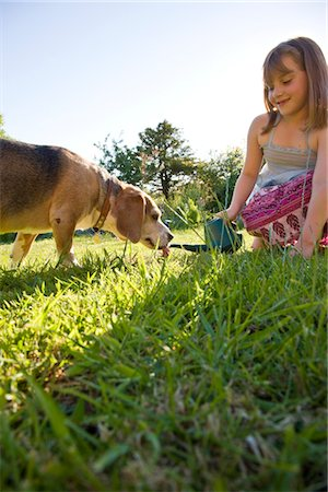 Young Girl Giving Dog Water from a Watering Can Stock Photo - Rights-Managed, Code: 822-03601974