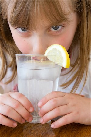 Girl Drinking Water with Ice and Lemon Stock Photo - Rights-Managed, Code: 822-03601989