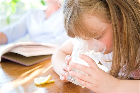 Girl Drinking Water with Ice and Lemon Stock Photo - Rights-Managed, Code: 822-03601990