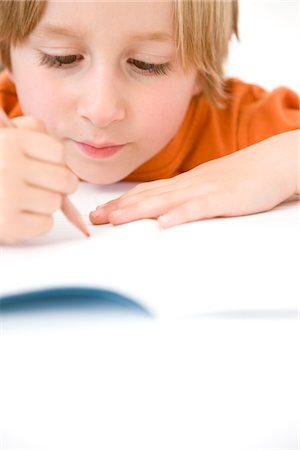 Young Boy Writing Stock Photo - Rights-Managed, Code: 822-03602015
