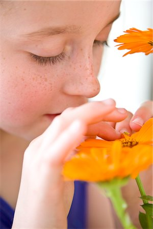 preteens fingering - Young Girl Inspecting Orange Flower Stock Photo - Rights-Managed, Code: 822-03602069