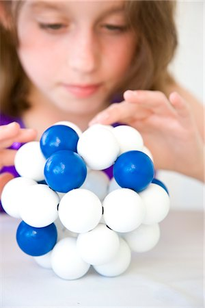 Girl Inspecting Atom Model Stock Photo - Rights-Managed, Code: 822-03602062