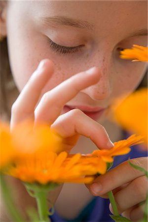 preteens fingering - Young Girl Inspecting Orange Flower Stock Photo - Rights-Managed, Code: 822-03602084