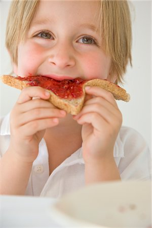 Boy Eating Jam on Toast Stock Photo - Rights-Managed, Code: 822-03602088