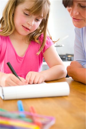 supervising - Mother and Daughter Doing Homework Stock Photo - Rights-Managed, Code: 822-03602096