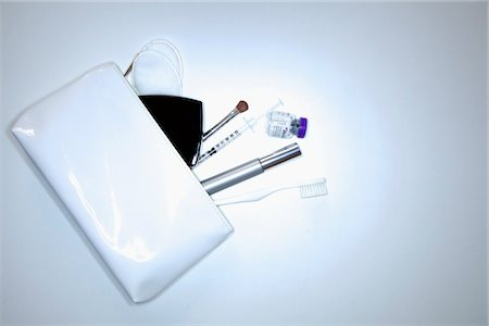 White Purse and its Contents Stock Photo - Rights-Managed, Code: 822-03780634
