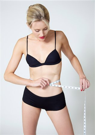 Woman Measuring Waist Stock Photo - Rights-Managed, Code: 822-03780633