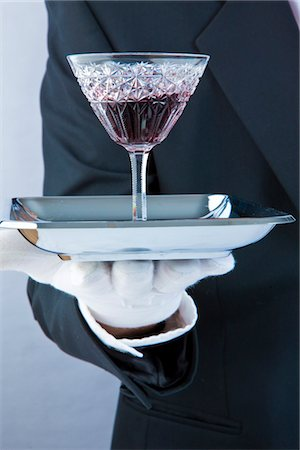 Waiter's Gloved Hand Holding Tray with Glass of Port Stock Photo - Rights-Managed, Code: 822-03780657