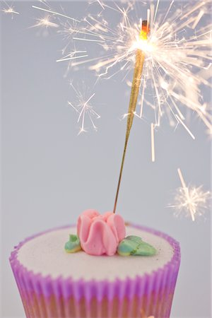 sparks with white background - Sparkler on a Cupcake Stock Photo - Rights-Managed, Code: 822-03780661