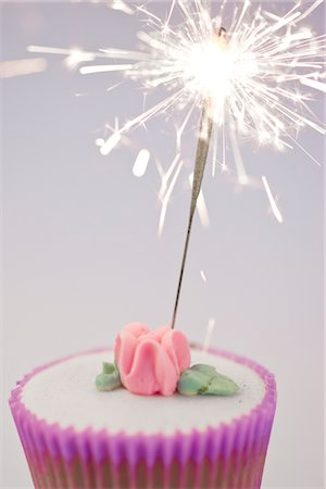 sparks with white background - Sparkler on a Cupcake Stock Photo - Rights-Managed, Code: 822-03780662