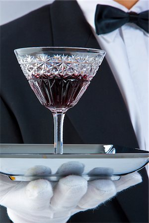 Waiter's Gloved Hand Holding Tray with Glass of Port Stock Photo - Rights-Managed, Code: 822-03780684