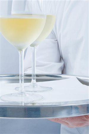 Waiter Holding Tray with Glasses of White Wine - Close-up view Stock Photo - Rights-Managed, Code: 822-03780712