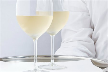 Waiter Holding Tray with Glasses of White Wine - Close-up view Stock Photo - Rights-Managed, Code: 822-03780720