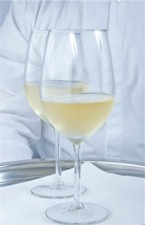 Waiter Holding Tray with Glasses of White Wine - Close-up view Stock Photo - Rights-Managed, Code: 822-03780722