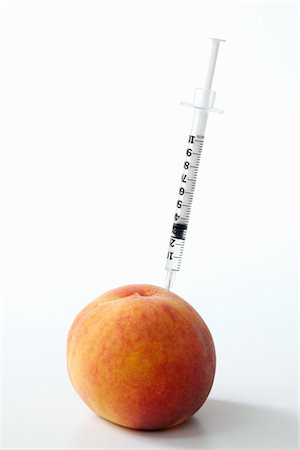 Hypodermic Needle Inserted in a Peach Stock Photo - Rights-Managed, Code: 822-03780735