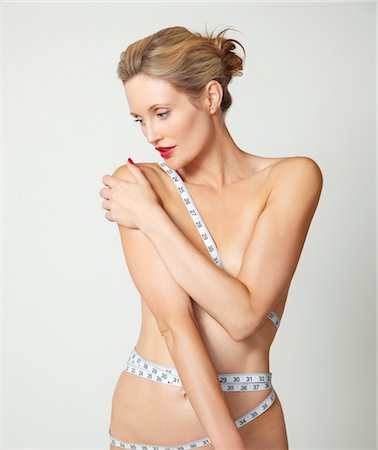 Nude Woman with Tape Measure Wrapped around Body Stock Photo - Rights-Managed, Code: 822-03780739